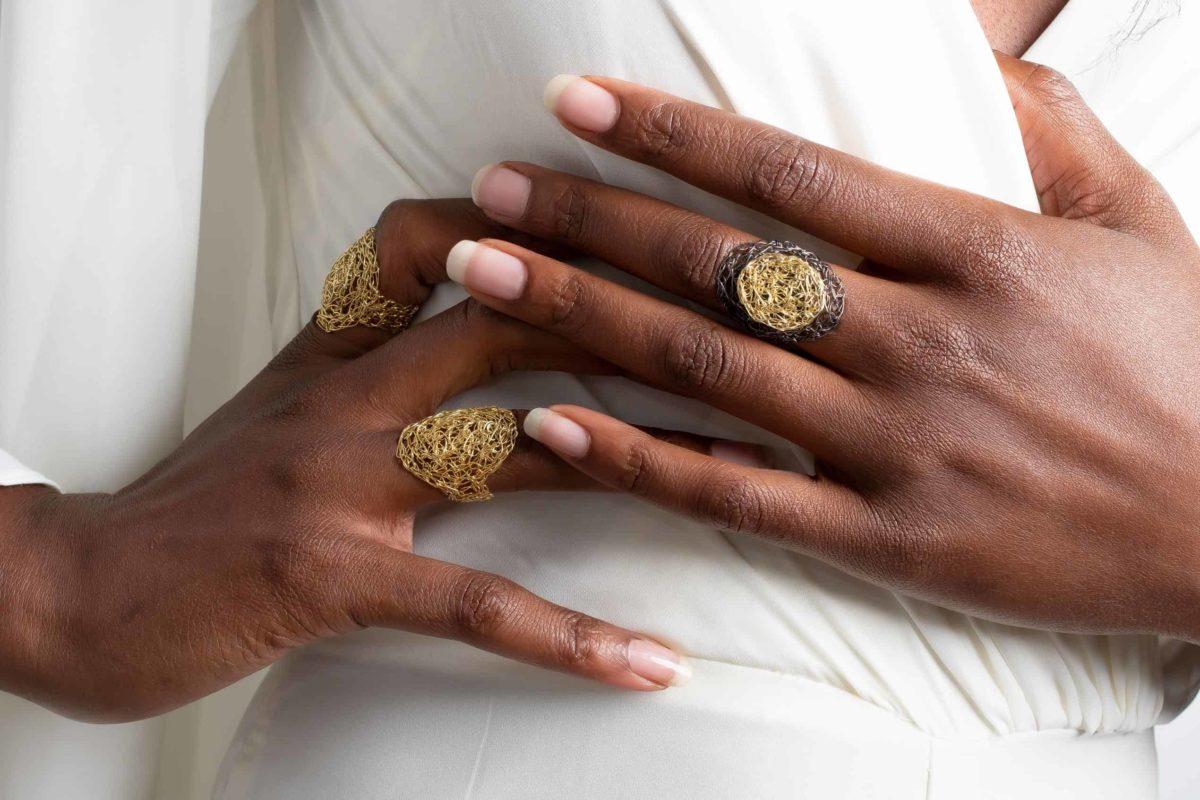 black model wearing adjustable rings in gold