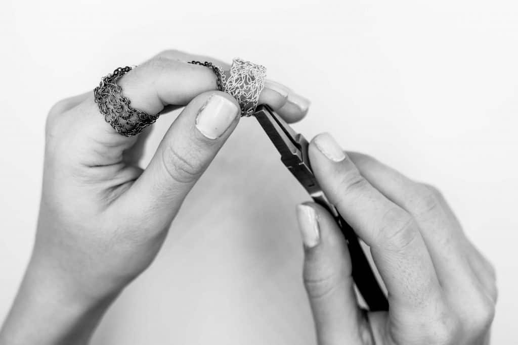 Maria Glezelli hands making a slave ring