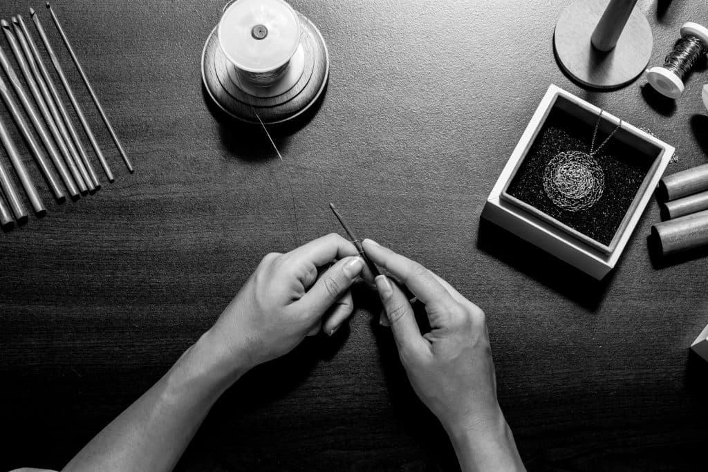 Maria Glezelli making ethical jewelry from her workshop