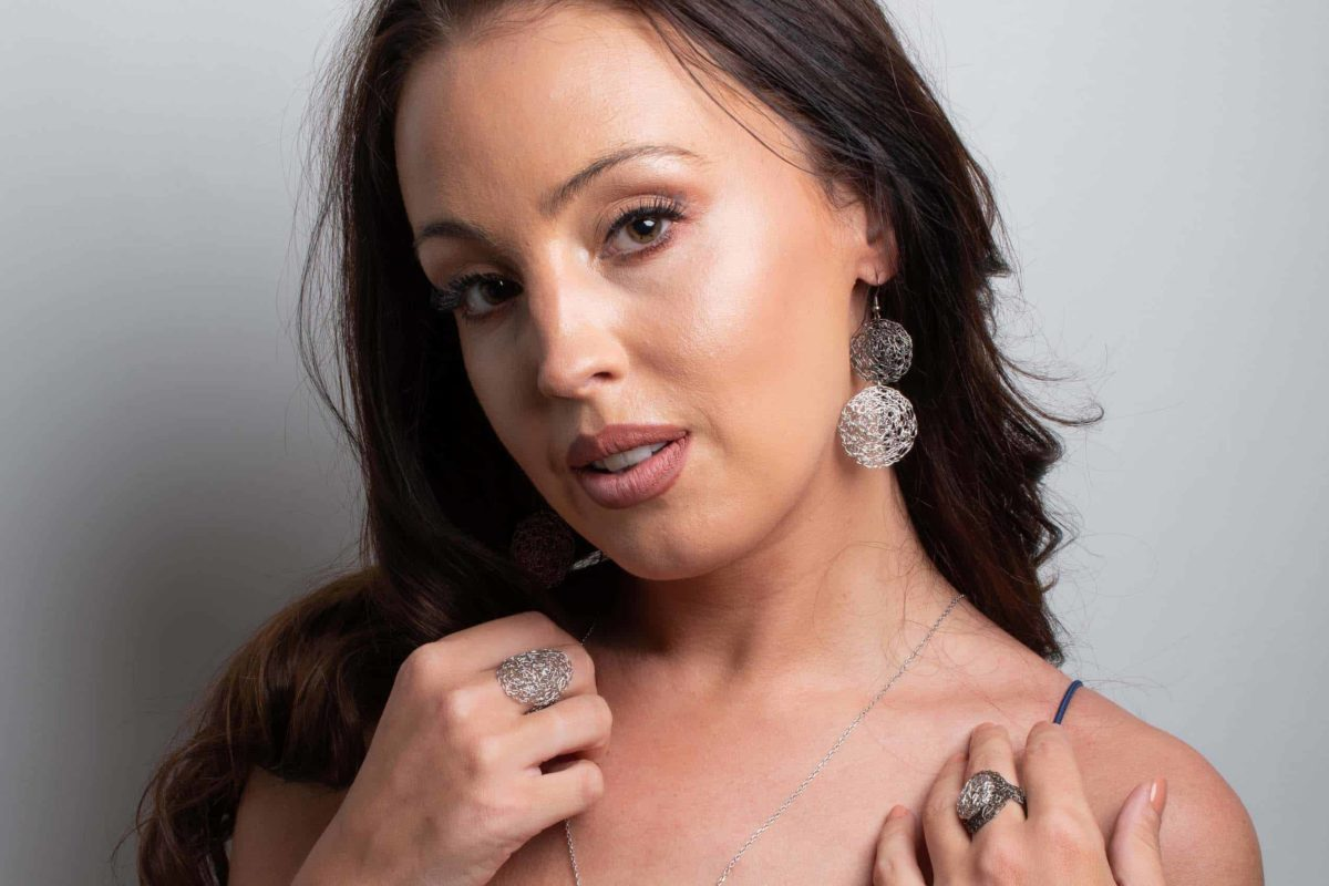 model wearing silver earrings
