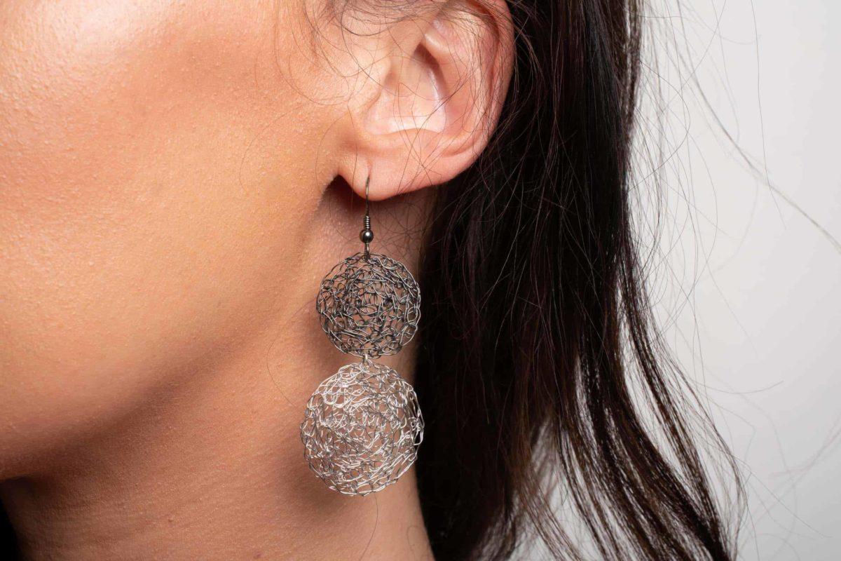 detail of silver statement earrings