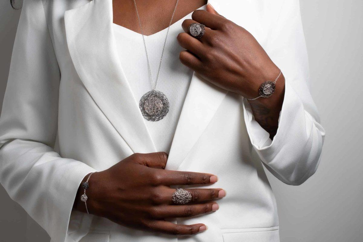 black model wearing weightless jewelry in silver