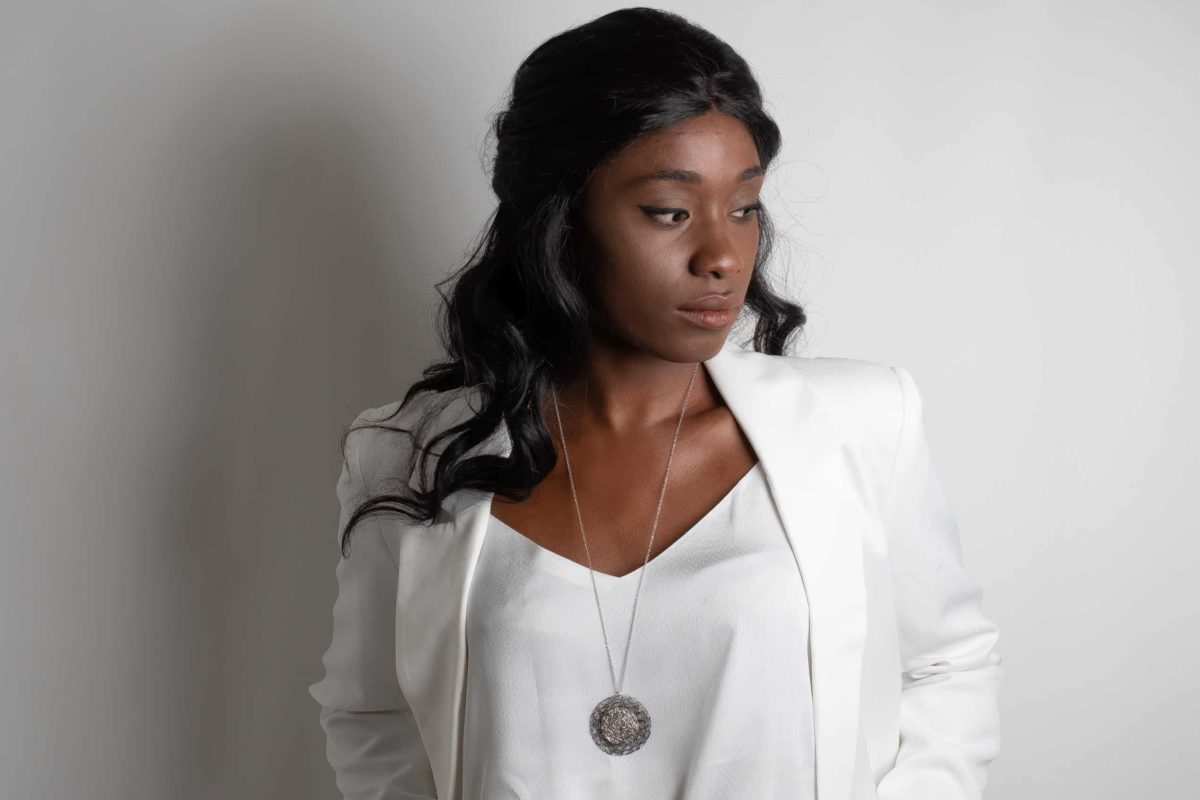 model wearing silver circle pendant necklace