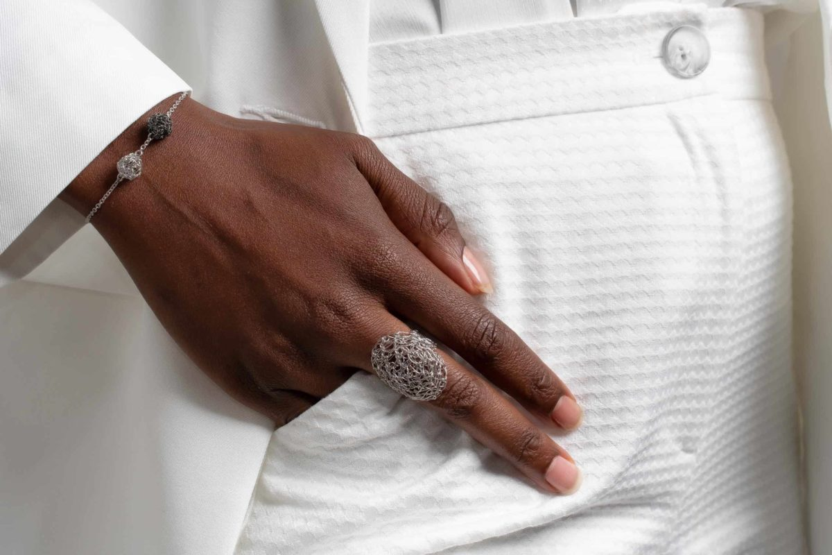 detail of model wearing adjustable ring in silver