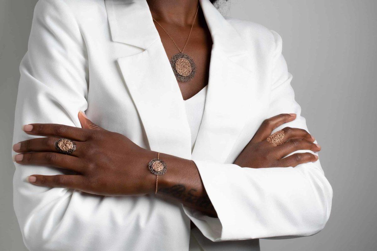 model wearing rose gold circle pendant necklace