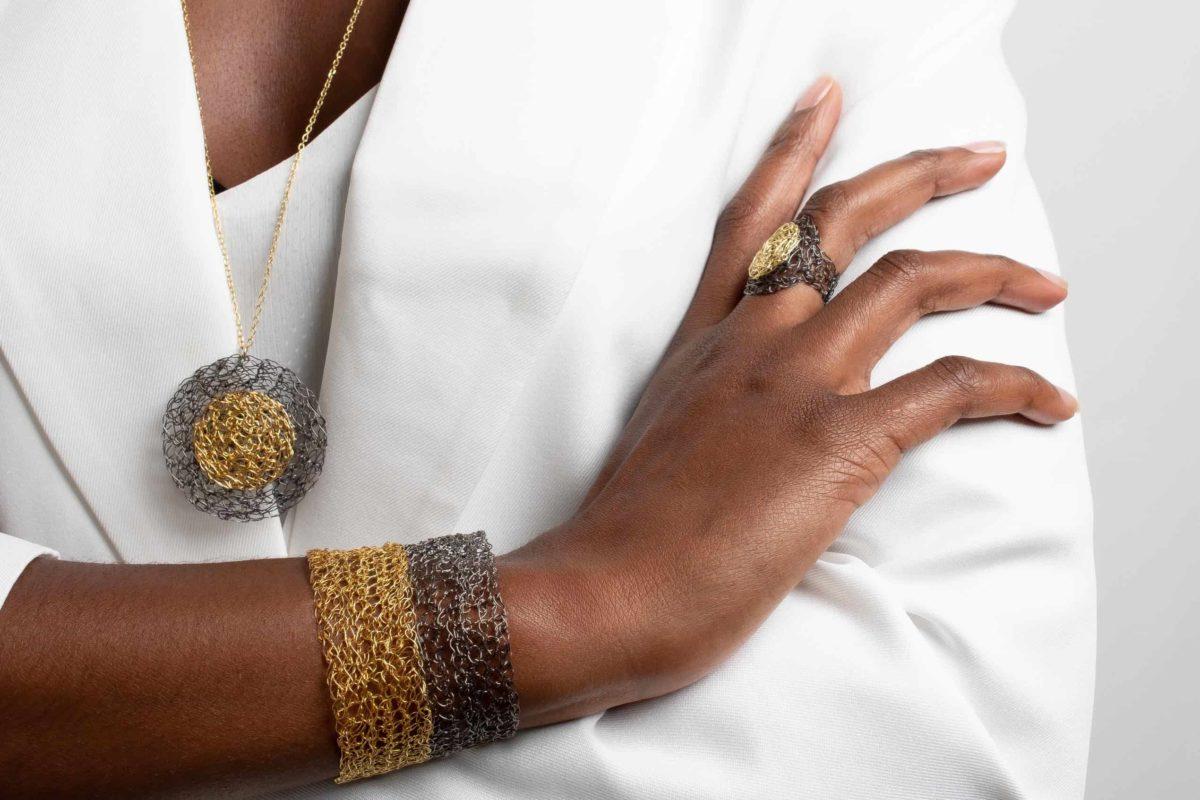 model wearing gold bangle bracelet