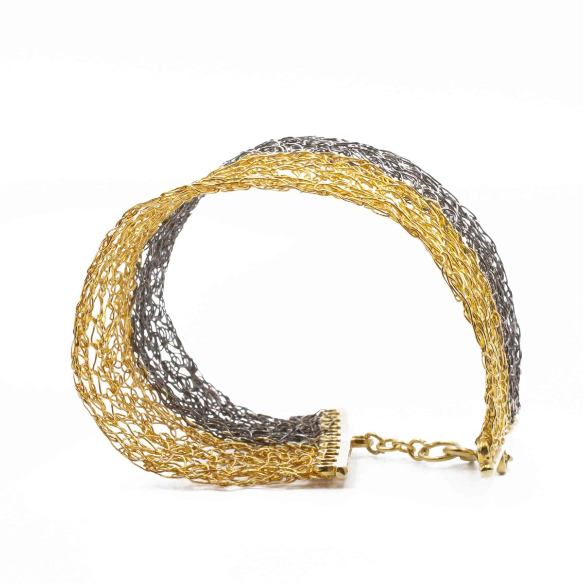 top view of gold and black rhodium cuff bracelet for women