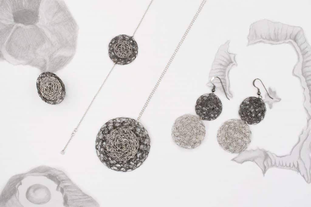 Maria Glezelli sketches with silver jewelry