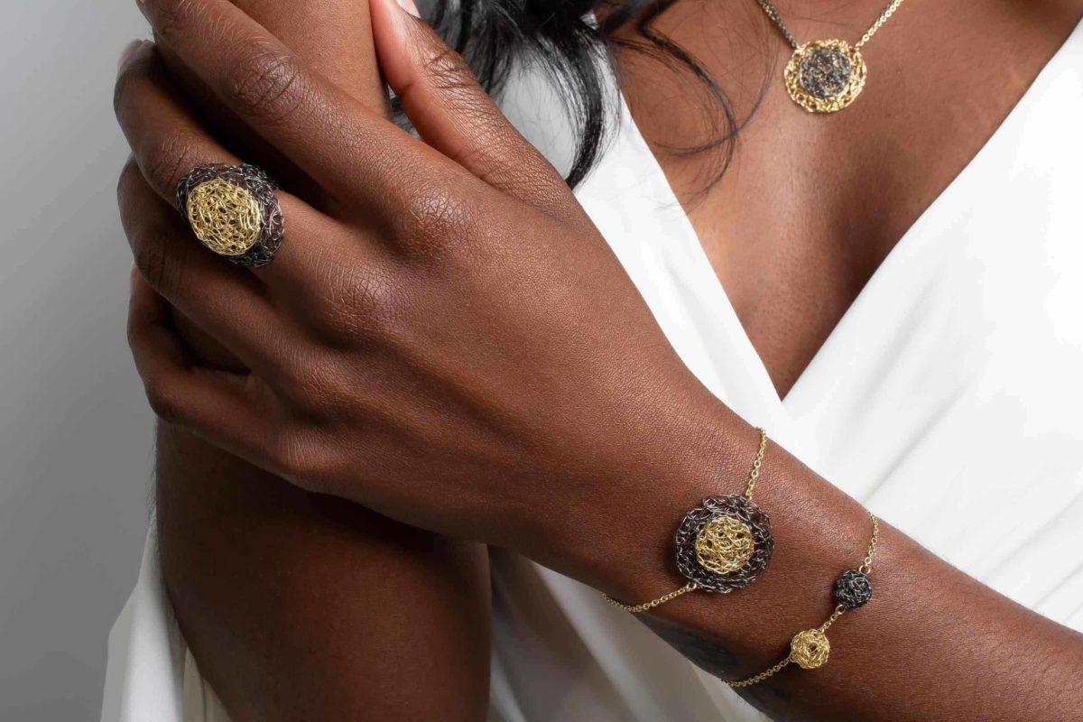 handmade gold jewelry on model