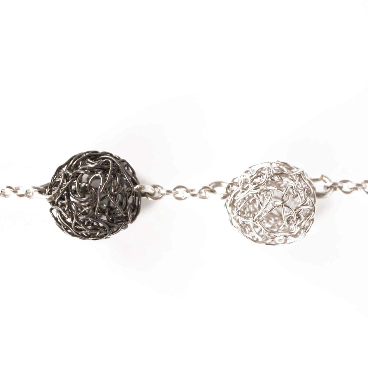 detail of handmade silver sphere