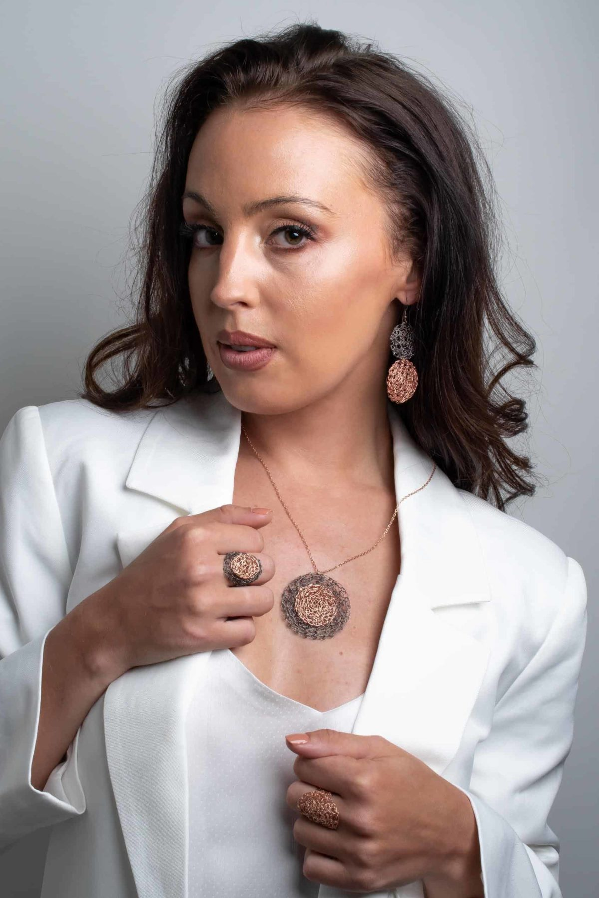white model wearing rose gold jewelry