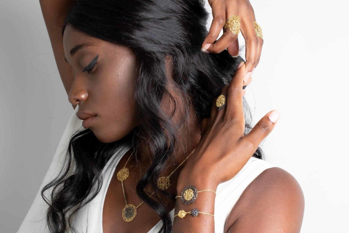model wearing weightless gold jewelry
