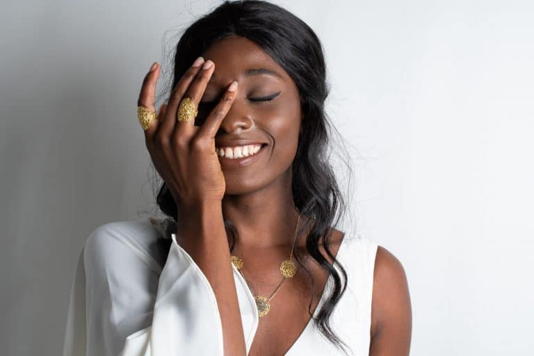 Black model wearing gold handmade jewelry
