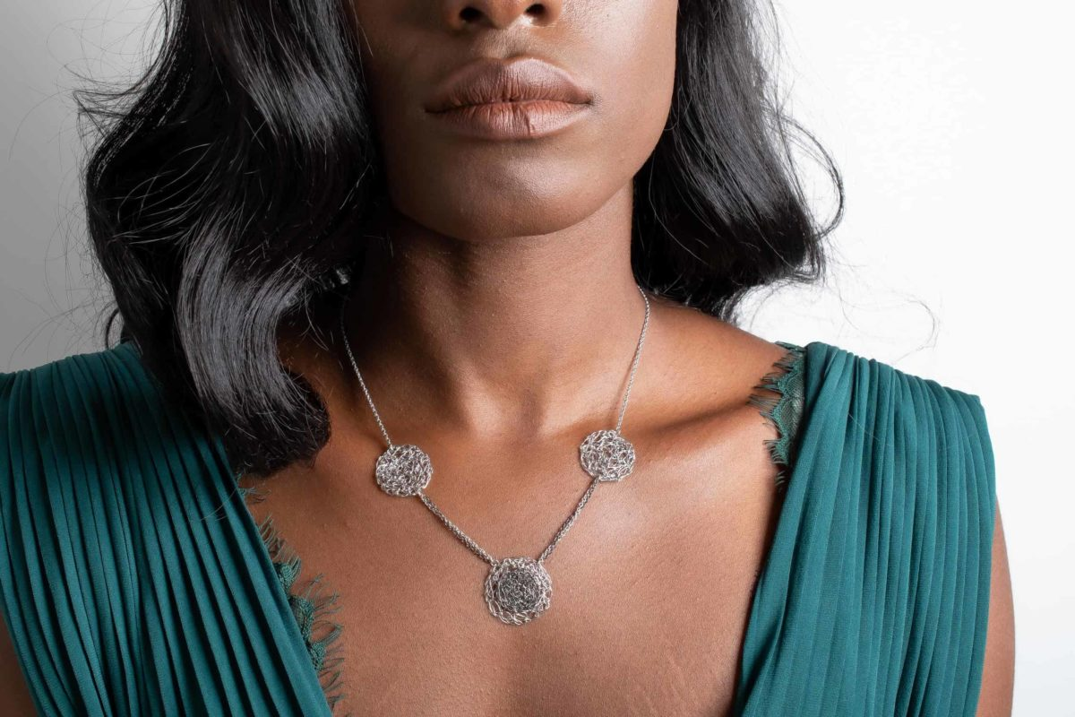model wearing silver circle necklace