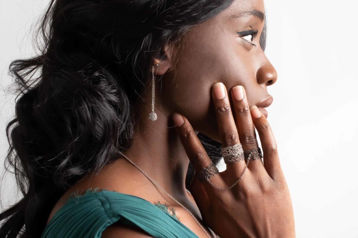 black model displaying a stacked and a slave ring