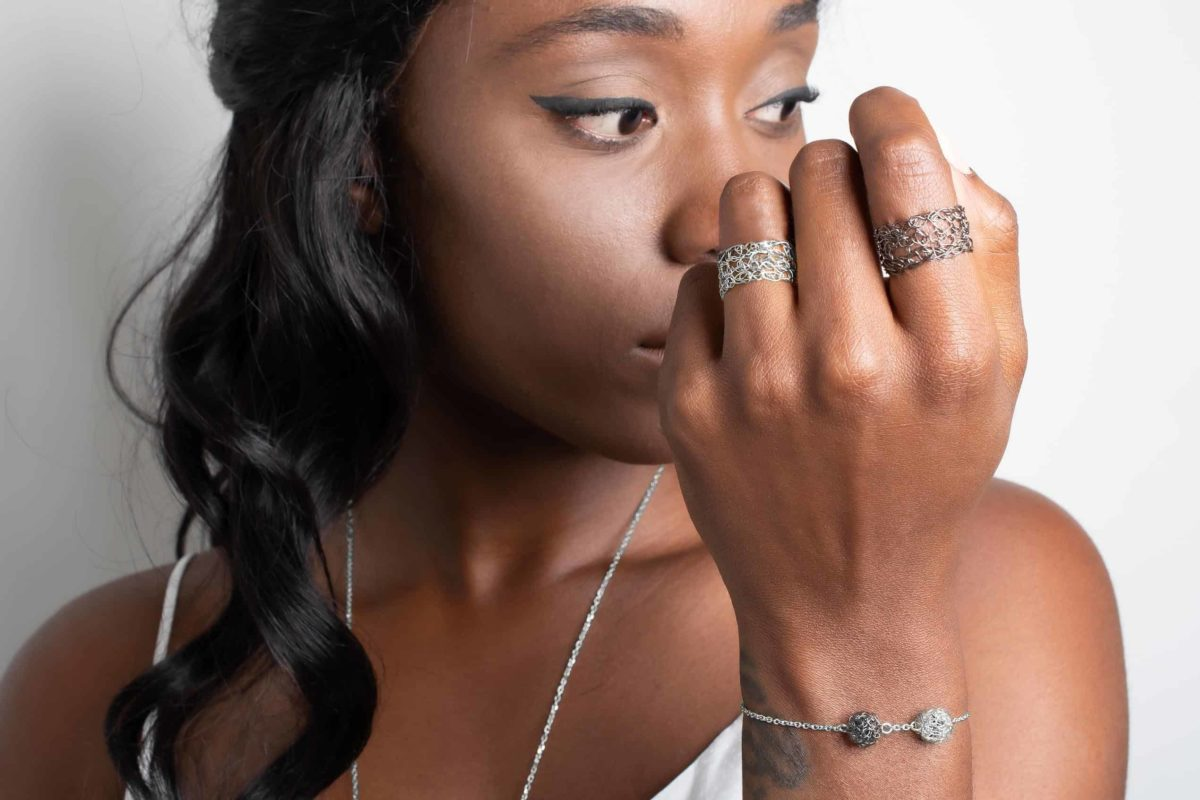 Black model wearing sterling silver stacking rings
