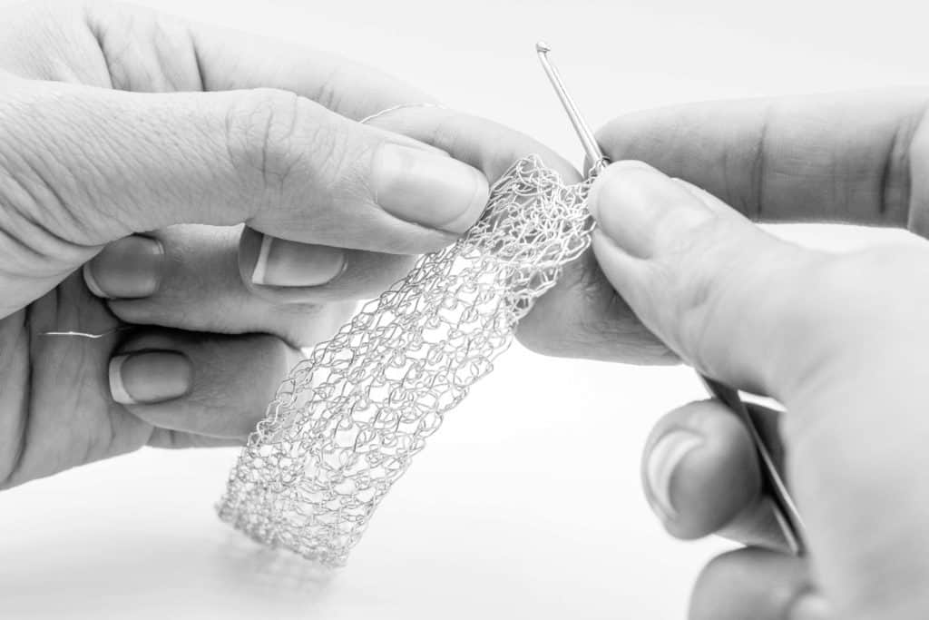 Maria Glezelli knitting a woven bracelet for women